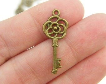 10 Key charms antique bronze  tone BC150