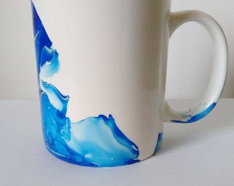 White mug with blue and green marbling/dip dyed