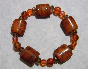 Pillow Shaped Orange & Brown Art Glass, CZs and Faceted Glass Stretch Bracelet