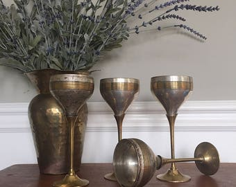 Set of four vintage brass and silver goblets