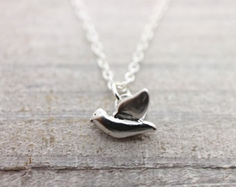 Tiny flying bird silver necklace
