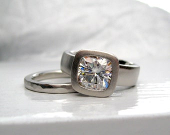 950 palladium wide band cushion cut moissanite engagement ring with matching hammered wedding band