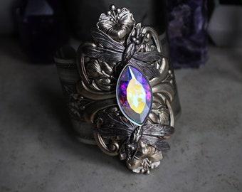 Ostara • Gorgeous ethereal avant garde spring inspired fantasy bracelet cuff with dragonflies, flowers, and a brilliant rainbow rhinestone