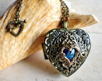 Heart music box locket, heart shaped locket with music box inside, in bronze with blue crystal heart.