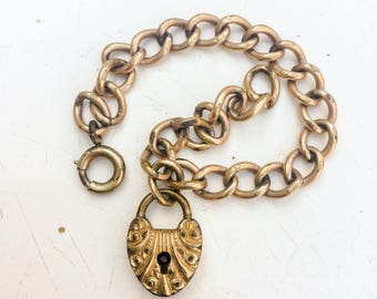 Victorian repousse bracelet. heart shaped padlock clasp. Antique jewelry. Gold fill bracelet. No Key LA eb