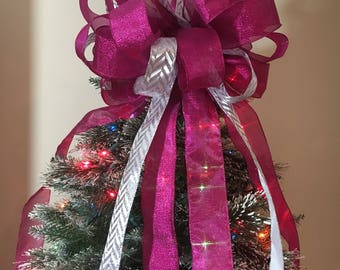 large shimmering pink ribbons and a silver chevron stripe ribbon  Christmas Tree topper bow