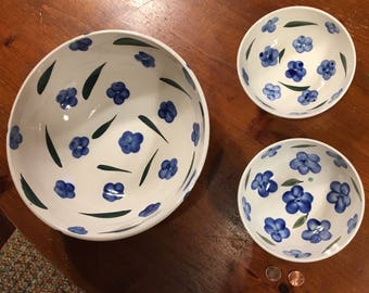 Set of ceramic serving bowl and two small bowls with blue flower design