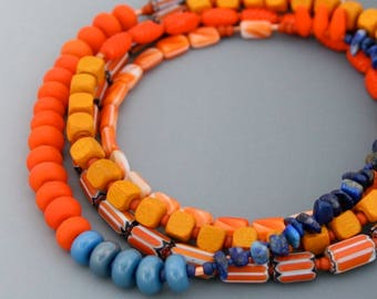 Long necklace in oranges and blues. No clasp. Layering necklace, light weight and unique.