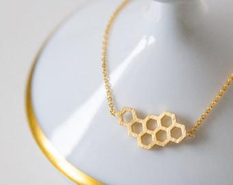 Gilded bracelet with honeycomb pendant