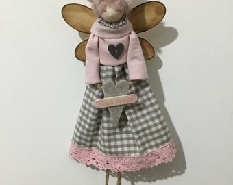 Decorative doll with message.