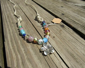 Mixed color flower beaded necklace with silver flower pendant and two suede chords