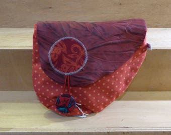 P02 bag in red dot fabric with a red leather flap