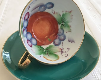 Ucagco Teacup and Saucer - Hand Painted in Japan