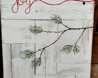 Joy, pallet art with hand painted pine tree branch and  Christmas ornament globe.