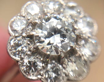 Edwardian diamond cluster engagement ring in platinum, from about 1920
