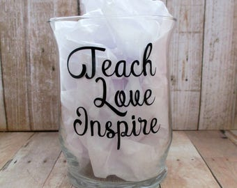 "Teach, Love, Inspire.  Clear Hurricane glass candle holder. Decorative saying. 4.5"" tall by 3.25"" wide."