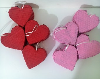 8 small pink and red hearts pinatas