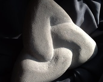 Three, a triskele knot limestone carving