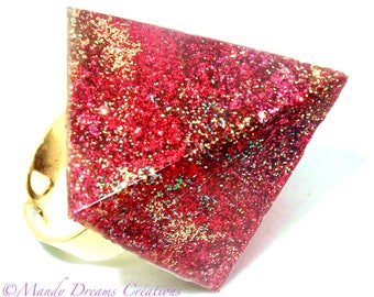Bright ring pyramid resin casting, red sequins, golden, fuschias