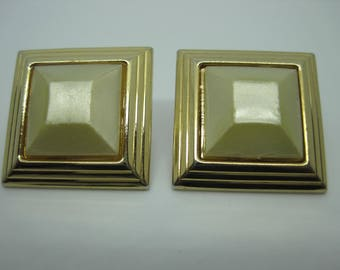Vintage 60's Pearlescent square plastic bead and gold tone metal setting stud earrings.
