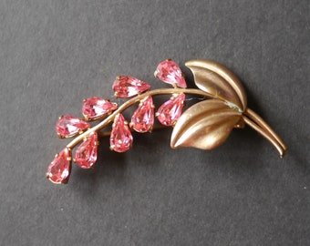 Gold tone flower brooch with pink rhinestones