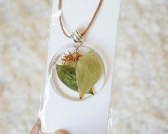 Resin necklace with dried flowers and leaves