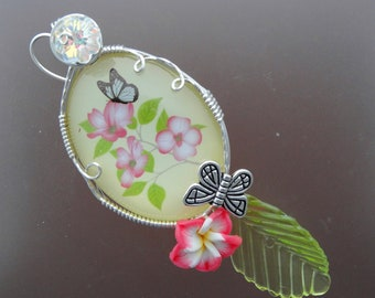 Wire wrapped acrylic cameo w/ butterflies and flowers