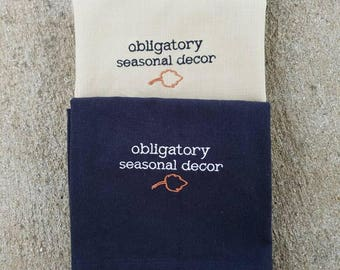 Obligatory seasonal decor fall towel - set of 2 in natural or black. Funny kitchen gift. Tiny leaf or pumpkin. Holiday grinch gift.
