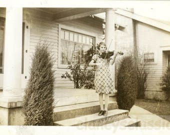 Vintage photo 1934 Young Girl Plays Music on her Violin on Front Steps