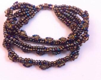 handmade beaded triple strand bracelet