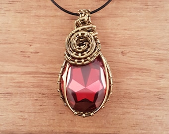 Bronze wire wrapped Swarovski red magma pear drop pendant necklace