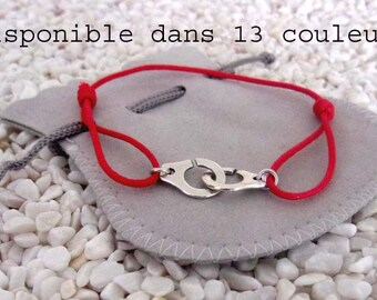 handcuffs bracelet with red ajustable cord