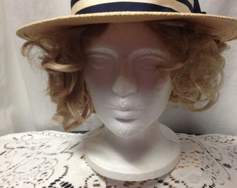 1970s Straw Hat with Bone and Navy accents. Designed by Joe Bill Miller and made in the USA. Great for boating, polo, brunch or cruises.