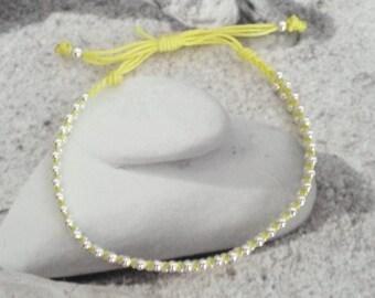 Child neon yellow beaded braided bracelet