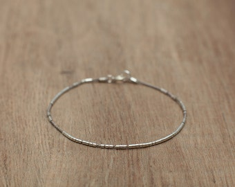 Delicate bracelet with tiny sterling silver beads on a Silk cord. Minimalist