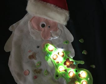 Ugly christmas sweater with lights Santa vomiting up gingerbread cookies and peppermint candy and sprinkles - ladies and mens available
