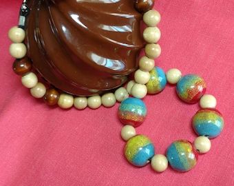 Rainbow wooden bead necklace, comfortable on neck and fun to wear.