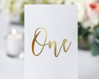 table number cards gold foil Aura font
