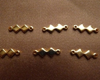 Link, gold-plated brass, 7x4mm double diamond, Pack Of 18 links.