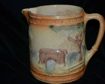 1800's Pottery Pitcher with Farm Design