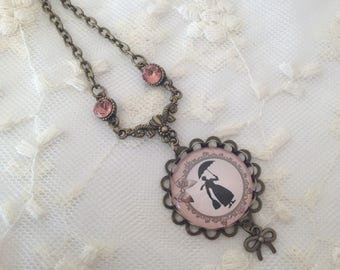 Mary Poppins Black and pink cameo necklace.