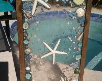 Medium shade wood with shells, sea glass, and starfish