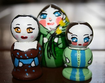 Miniature wooden doll trio