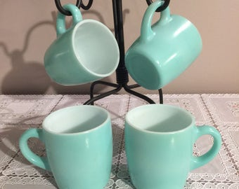 Set of 4 vintage Robin Egg coffee mugs. Numbered without manufacturers lsbel