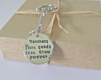 "Key Chain with a special message. "" Teachers plant seeds that grow forever""."