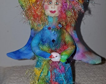 Enchanting fiber sculpted rainbow angel, silk face and Swarovski crystal accents