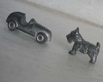 Dog and Automobile Game Tokens From Monopoly Game