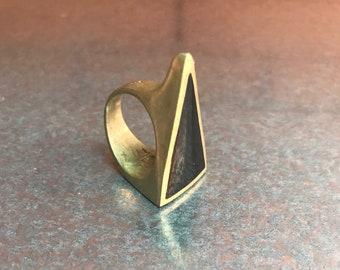 Bold black triangle ring