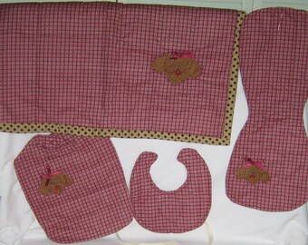 Maroon and white baby accessories