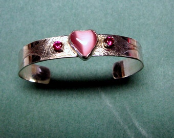 Hand etched sterling silver cuff with red and pink stones